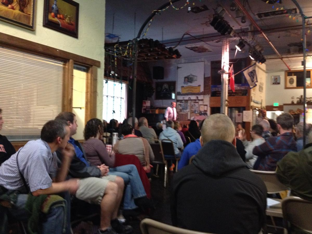 Dr. Pat Iversen spoke about Ebola treatments at a well-attended Corvallis Science Pub at the Old World Deli
